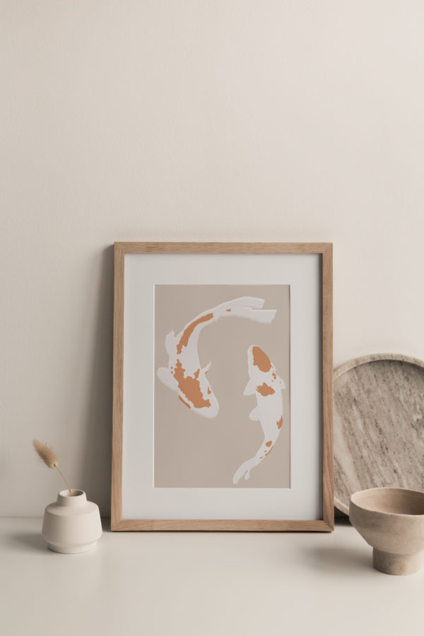 A stylish shot featuring a Framed Koi Print, marble plate and ceramic vases and bowls